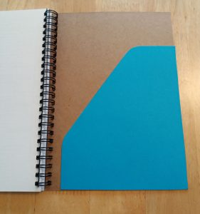 How to add a pocket in the back of a notebook