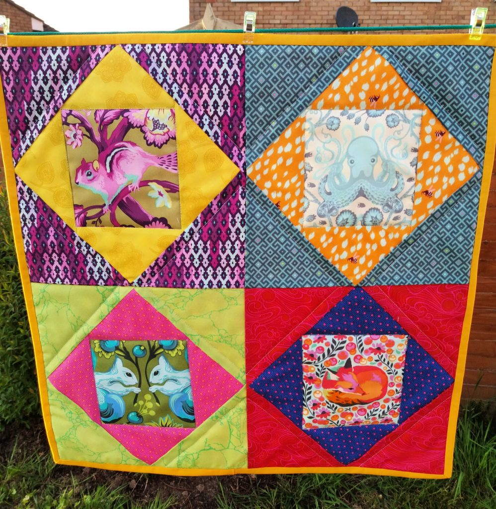 Economy block mini quilt with fussy cutting