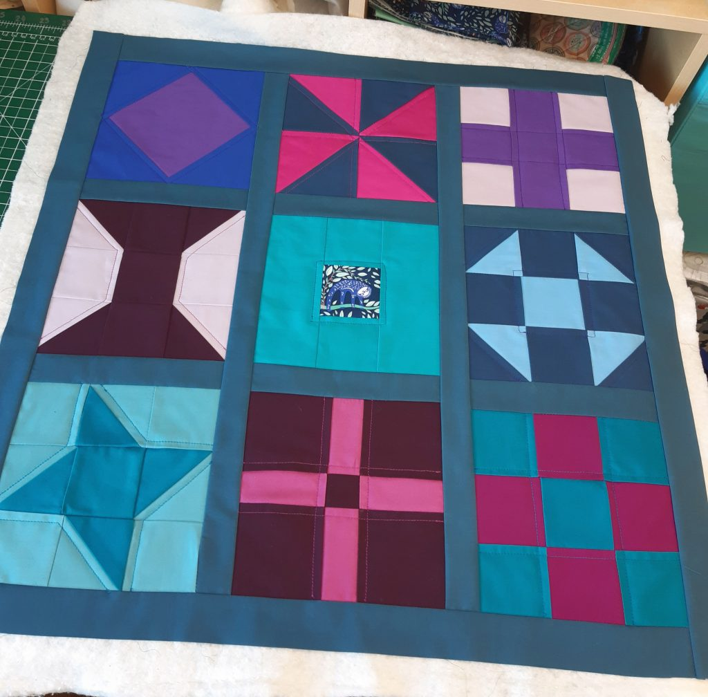 Simple sampler quilted cushion project